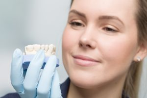 close up of female dental technician working on artificial dention